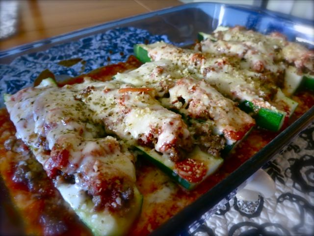 Turn extra zucchini into a simple and easy gormet dish that will impress and please by adding Italian sausage, mozzarella, marinara sauce, and some spices!  #WomenLivingWell #easyrecipe #zucchini #Italian