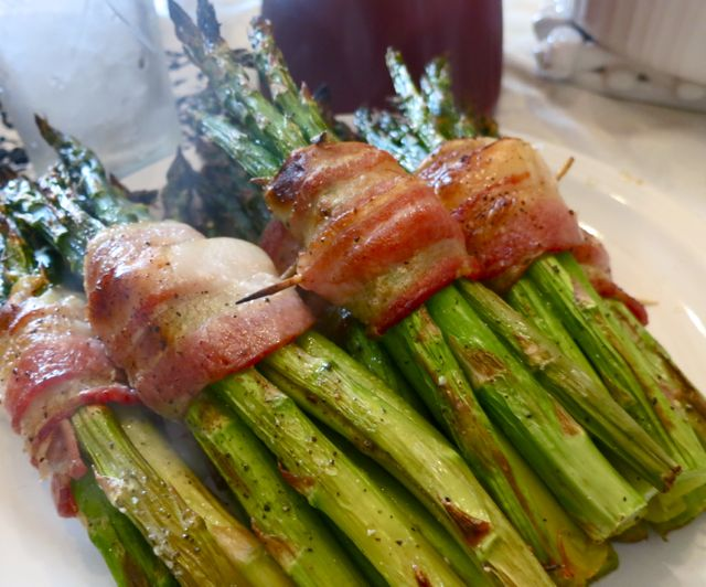 Whether you bake these asparagus in the oven or put them on the grill, they are sure to be an instant favorite side dish; or serve them for a light dinner. #WomenLivingWell #asparagus #bacon #grill